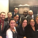 Omni Providence's Front Office takes a team shot with their new Omni selfie stick