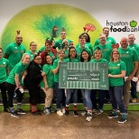 Reynolds associates volunteering at the Houston Food Bank.
