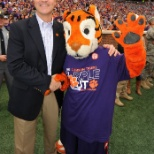 New president, Jim Clements, and the tiger mascot at the Military Appreciation game vs Citadel.