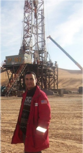 Running a completion job for an oil well.Algerian desert