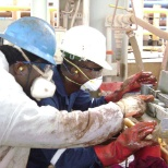 ExxonMobil photo: Mud Engineers troubleshooting a malfunctioning equipment