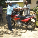 Presenting a motor bike to one of IRC's local implementing partners for the GBV program.