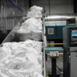 Superior Health Linens photo: Conveyor to our tunnel washer