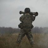 A photo of me firing an AT4 rocket launcher during a live fire training exercise in Germany.