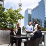 Sunny outdoor meeting on CI's rooftop patio