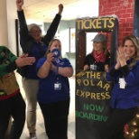 Ascension Medical Group associates celebrate their win during the holiday decoration contest.