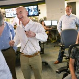 The Washington Post photo: Jeff Bezos strikes a triangle, which summons editors for the afternoon planning meeting.