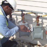 Corix Utility Services photo: Gas Meter module installer
