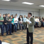 CEO Gabe Tirador delivering the annual Company update during a visit to the FL office