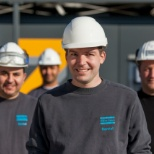 Atlas Copco employees on a job site.