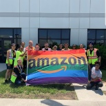 Amazon BWI2 Glamazon Committee takes a picture with the Glamazon pride flag before we raise it! #Gla