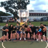 Singapore colleagues make time for wellness by ending their day with a game of basketball.