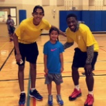 On the last day of our Basketball clinic/camp, with a camp member and former co-worker