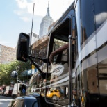 One of the Keystone Freight Corp. trucks driving past the Empire State Building.