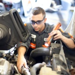 Inspecting a heavy duty diesel engine; our technicians work on a wide range of equipment.