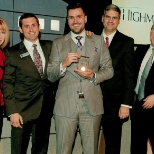 "Ideal Concepts, Inc. President John Pequeno accepting the ""Business of the Year"" award in Dec. 2015"