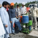 BECA photo: Checking for Asphalt thickness