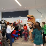 The IMS team worked as heroes, villains and dinos for Halloween