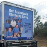 ON THE BACK OF THE GOODWILL TRUCKS (LEFT SITTING NEXT TO PENNY HARDAWAY)
