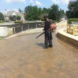 Laid pavers and sealed driveway.
