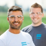 Atlas Copco employees happy to be on a job site.