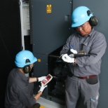 Atlas Copco Compressors employees working with digital equipment.