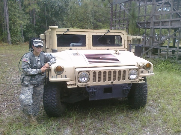 Leaning against my assigned military HMMWV after conducting a training excercise.