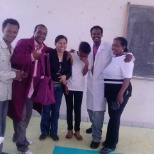 Some of my trained TVET trainers as they wear their overcoat project and bag
