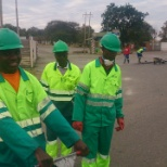 Lafarge photo: Safety day: Road potholes patching by the finance team
