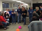 Employees gather for a team building exercise.
