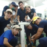 Helmerich & Payne photo: Me wearing a yellow cap with my maintenance staffs assembling new machines.