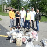 Team members cleaned the McDowell Grove Forest Preserve on the Dupage River.