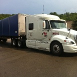 PGT Trucking, Inc photo: ProStar with Conestoga