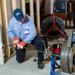 Roto-Rooter Plumbing & Drain Service photo: Technician with drain cleaning machine and inline camera