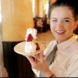 Smiling Server with Cheesecake