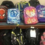 Our employees had fun filling back packs for the Communities That Care Back-to-School program.