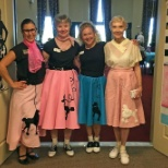 Staff and residents of Atria Canyon Creek enjoy the sock hop party.