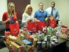 Source4Teachers corporate employees organizing relief packages for Hurricane Sandy Victims