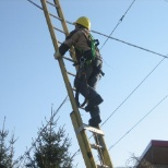 Technician Climbing Ladder