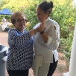 Atria Plainview staff member and resident share a dance in between dinner courses.