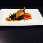 Trump Organization photo: Airline Chicken, beluga lentils, pancetta lardon, heritage carrots, chicken jus
