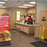 Wendy's inside store, customers view, cashier workplace.