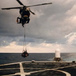 HSL-36's Detachment 7 SH-2F Seasprite delivering supplies to the USS Elmer Montgomery (FF-1082).