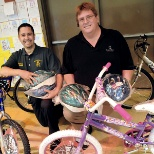 Exclusive Agent donating bikes to a school for a Perfect Attendance Spells Success (PASS) program