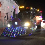 Bus decorated as a train for a holiday parade
