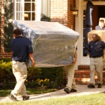JK Moving Services photo: Members of the residential team carefully manage a customer's move. Don't they look sharp?!