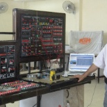 implementation of a Microcontroller (PIC) and Programmable Logic Controller (PLC)  Trainer