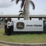 In front of John Deere India Pvt. Ltd. manufacturing plant. India.