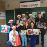 Santa's helpers (aka the ER staff) delivering presents to patients and families in need