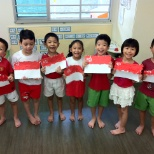 K2 children displaying their own creations of the Singapore Flag for National Day